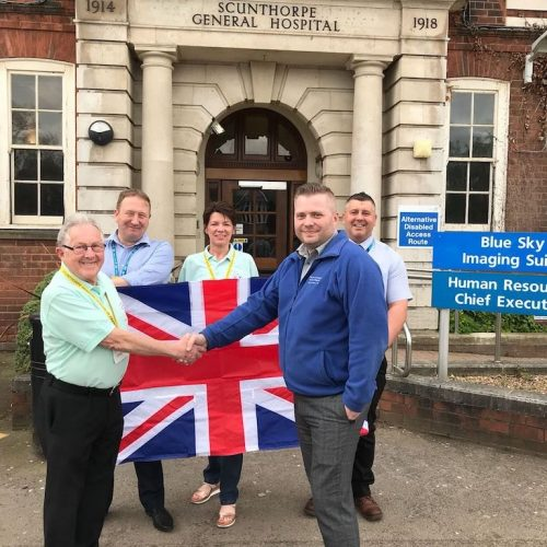 Volunteers with Flag outside Hospital